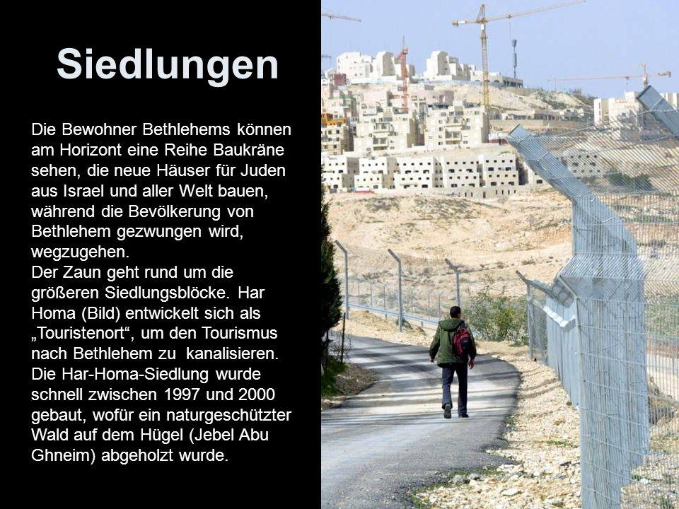 Siedlungen Die Bewohner Bethlehems können am Horizont eine Reihe Baukräne sehen, die neue Häuser für Juden aus Israel und aller Welt bauen, während di