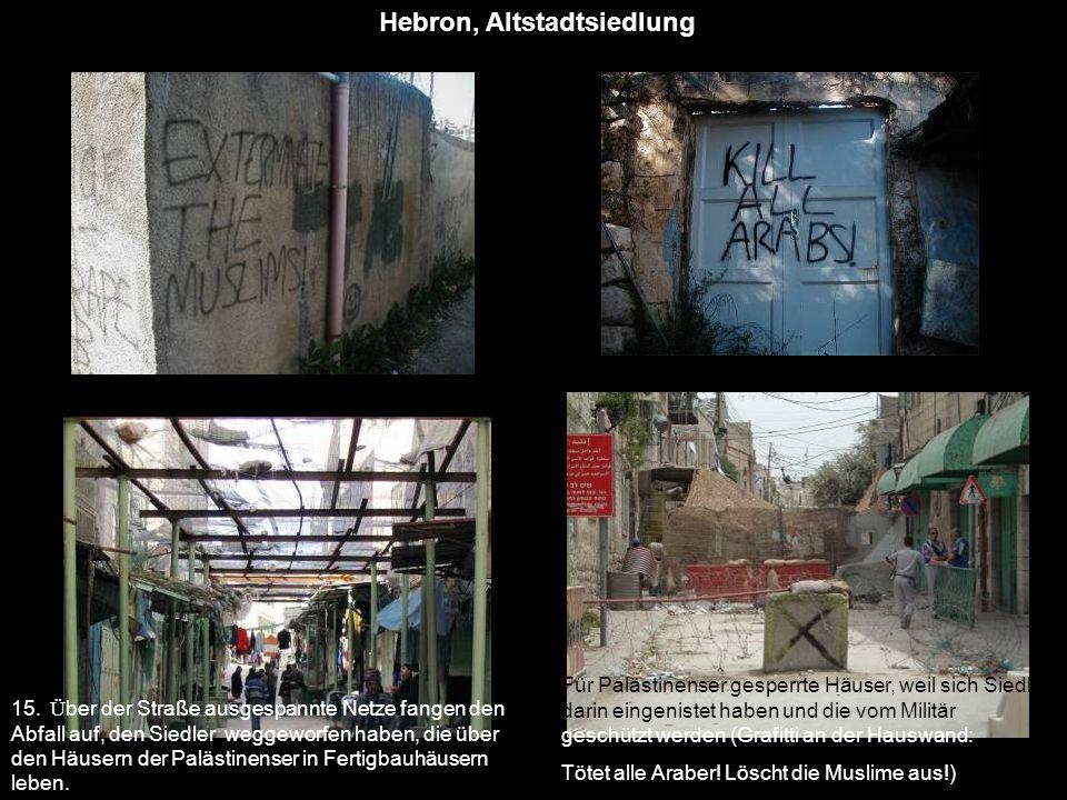 Hebron, Altstadtsiedlung 15. Ü ber der Straße ausgespannte Netze fangen den Abfall auf, den Siedler weggeworfen haben, die über den Häusern der Paläst