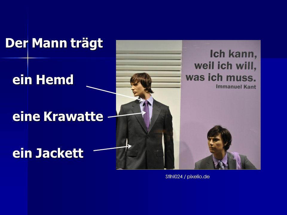 Der Mann trägt ein Hemd ein Hemd eine Krawatte eine Krawatte ein Jackett ein Jackett Stihl024 / pixelio.de