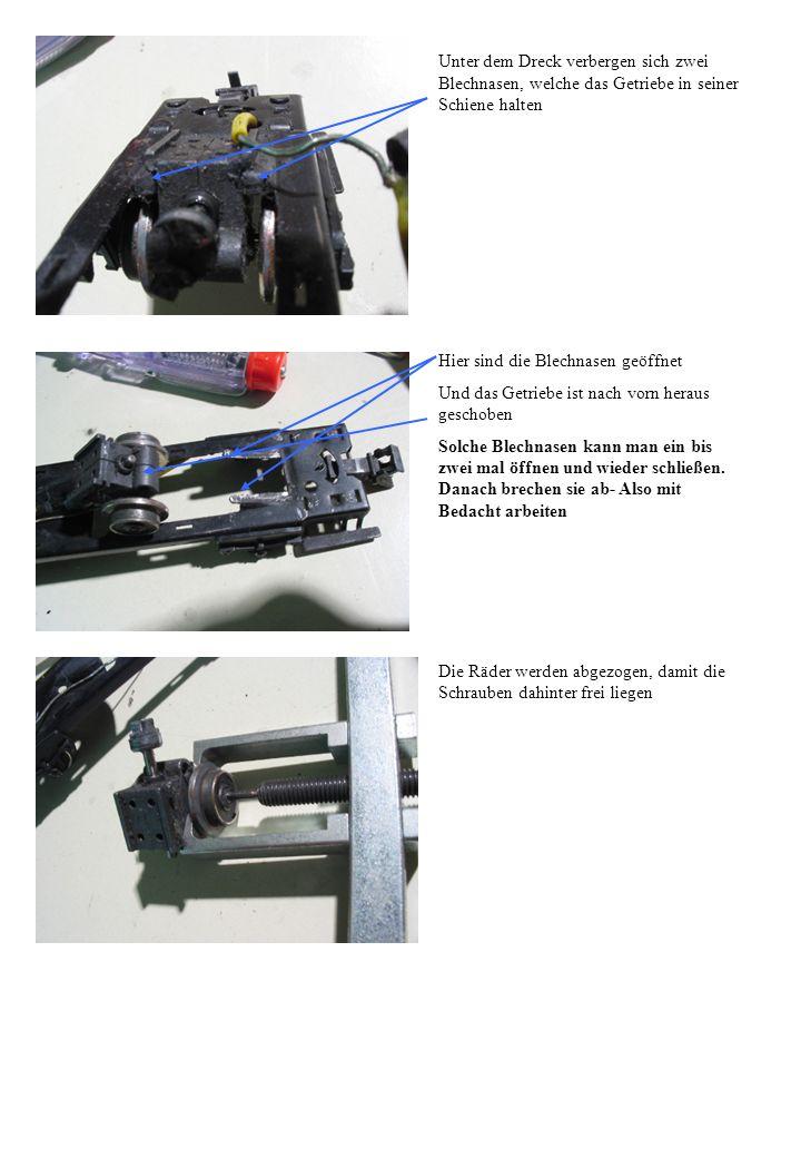 Unter dem Dreck verbergen sich zwei Blechnasen, welche das Getriebe in seiner Schiene halten Hier sind die Blechnasen geöffnet Und das Getriebe ist na