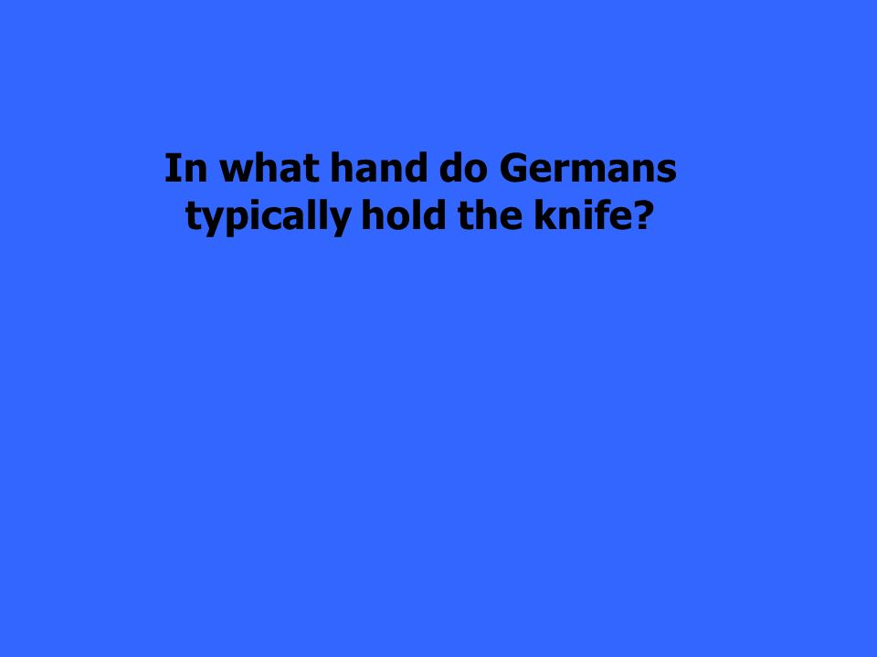 In what hand do Germans typically hold the knife?