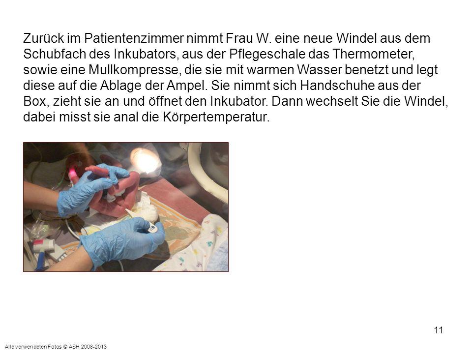 11 Zurück im Patientenzimmer nimmt Frau W. eine neue Windel aus dem Schubfach des Inkubators, aus der Pflegeschale das Thermometer, sowie eine Mullkom