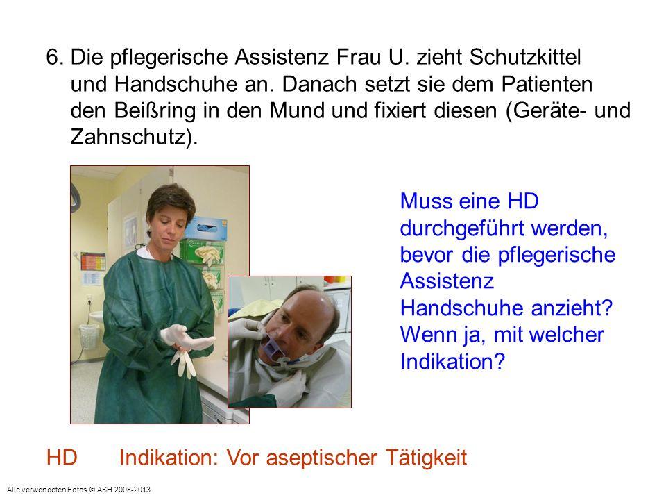6. Die pflegerische Assistenz Frau U. zieht Schutzkittel und Handschuhe an. Danach setzt sie dem Patienten den Beißring in den Mund und fixiert diesen