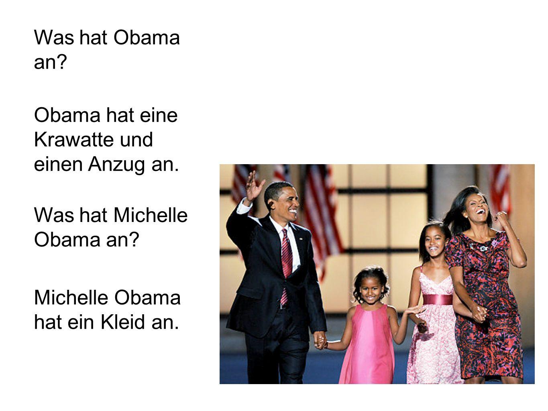 Was hat Obama an.Obama hat eine Krawatte und einen Anzug an.