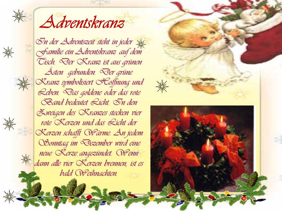 Adventskranz In der Adventszeit steht in jeder Familie ein Adventskranz auf dem Tisch. Der Kranz ist aus grünen Ästen gebunden. Der grüne Kranz symbol