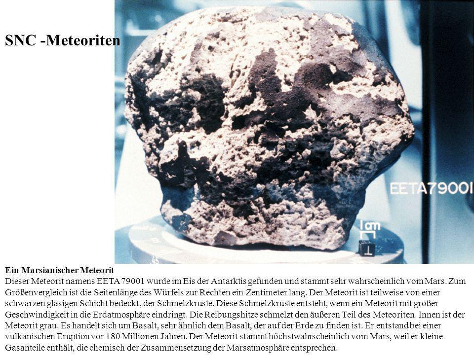 Ein Marsianischer Meteorit Dieser Meteorit namens EETA 79001 wurde im Eis der Antarktis gefunden und stammt sehr wahrscheinlich vom Mars. Zum Größenve