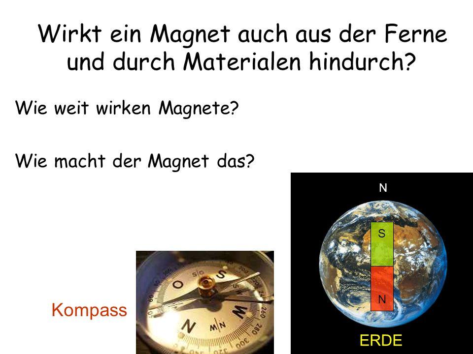 Wirkt ein Magnet auch aus der Ferne und durch Materialen hindurch? Wie weit wirken Magnete? Wie macht der Magnet das? Kompass ERDE N S N