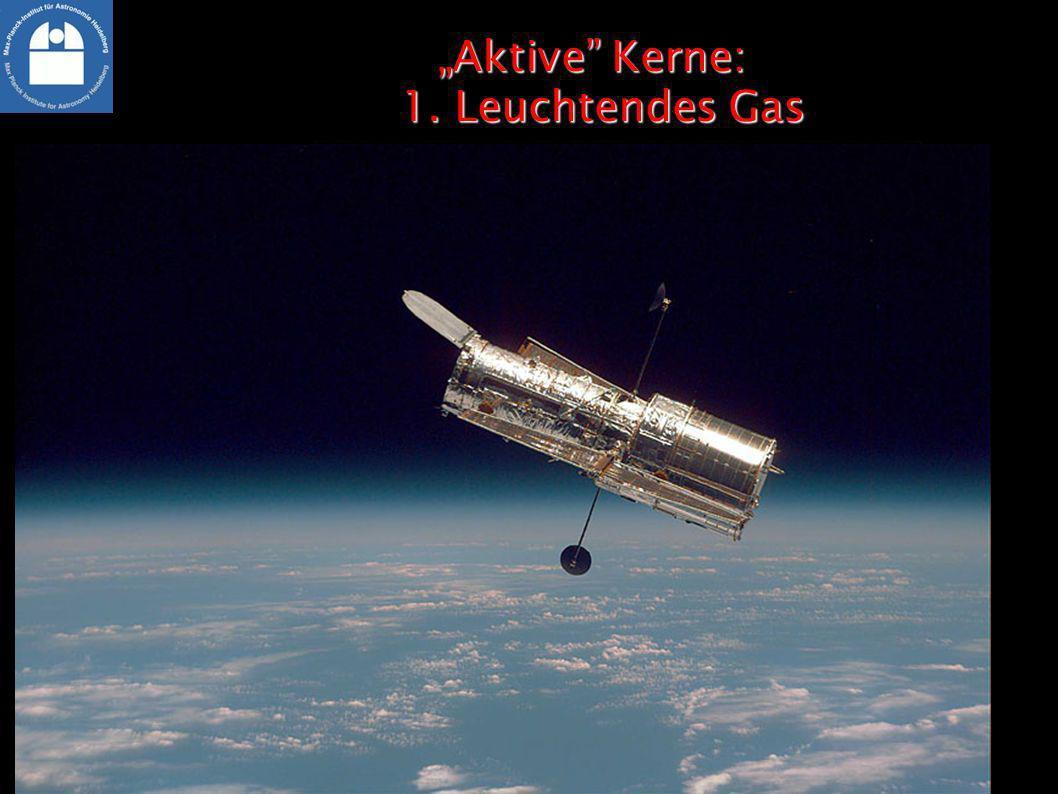 Aktive Kerne: 1. Leuchtendes GasAktive Kerne: 1. Leuchtendes Gas Leuchtendes Gas (violett und rot): Hinweis auf energetische Strahlung
