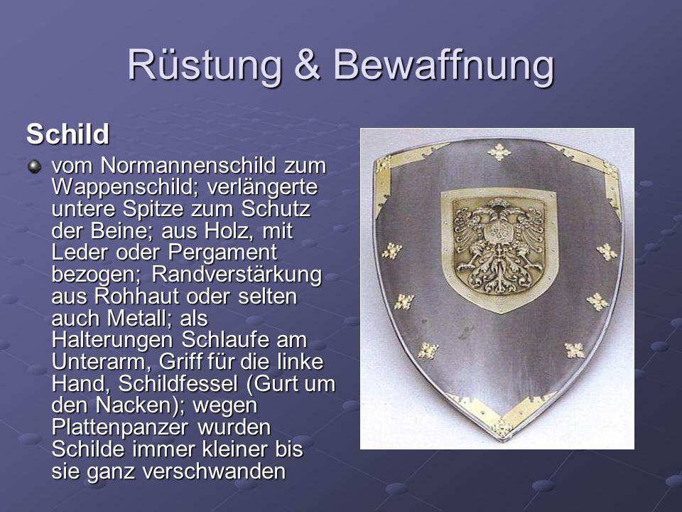 Rüstung & Bewaffnung Schild vom Normannenschild zum Wappenschild; verlängerte untere Spitze zum Schutz der Beine; aus Holz, mit Leder oder Pergament b