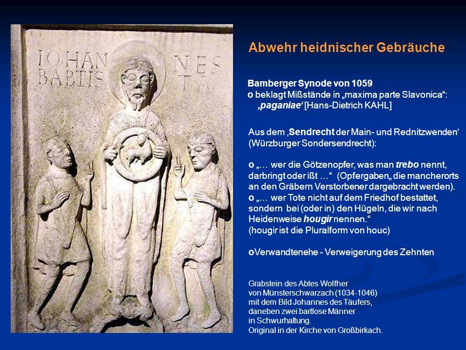 Grabstein des Abtes Wolfher von Münsterschwarzach (1034-1046) mit dem Bild Johannes des Täufers, daneben zwei bartlose Männer in Schwurhaltung. Origin