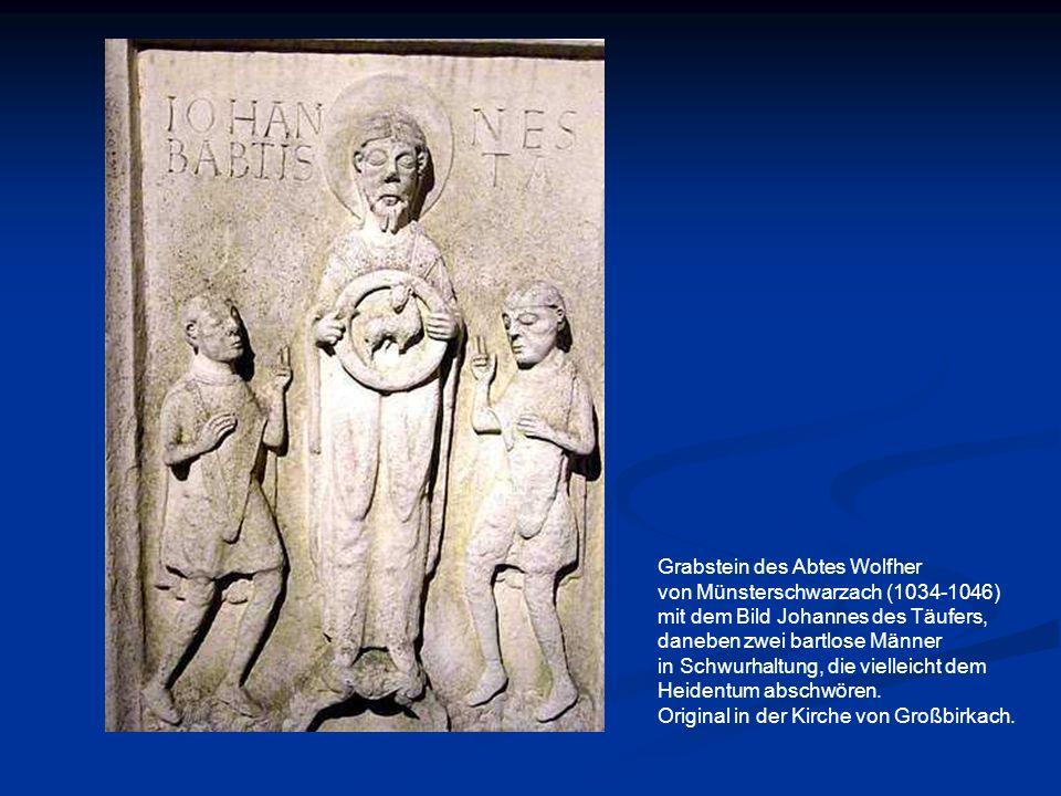 Grabstein des Abtes Wolfher von Münsterschwarzach (1034-1046) mit dem Bild Johannes des Täufers, daneben zwei bartlose Männer in Schwurhaltung, die vi