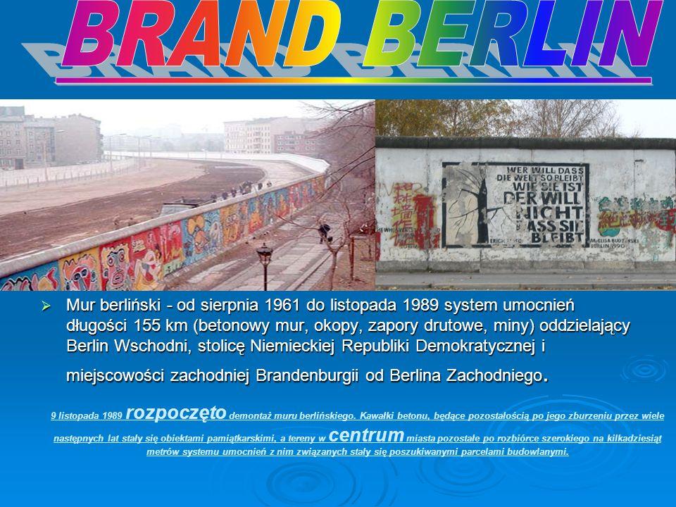 Mur berliński - od sierpnia 1961 do listopada 1989 system umocnień długości 155 km (betonowy mur, okopy, zapory drutowe, miny) oddzielający Berlin Wsc