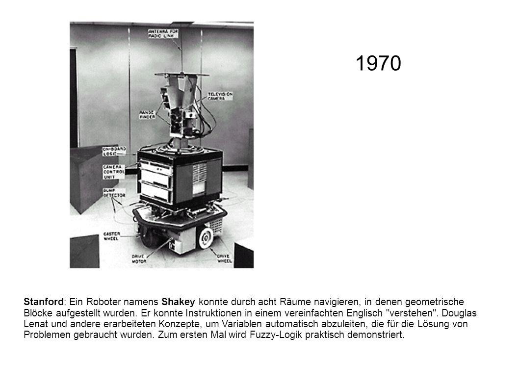 Stanford: Ein Roboter namens Shakey konnte durch acht Räume navigieren, in denen geometrische Blöcke aufgestellt wurden. Er konnte Instruktionen in ei