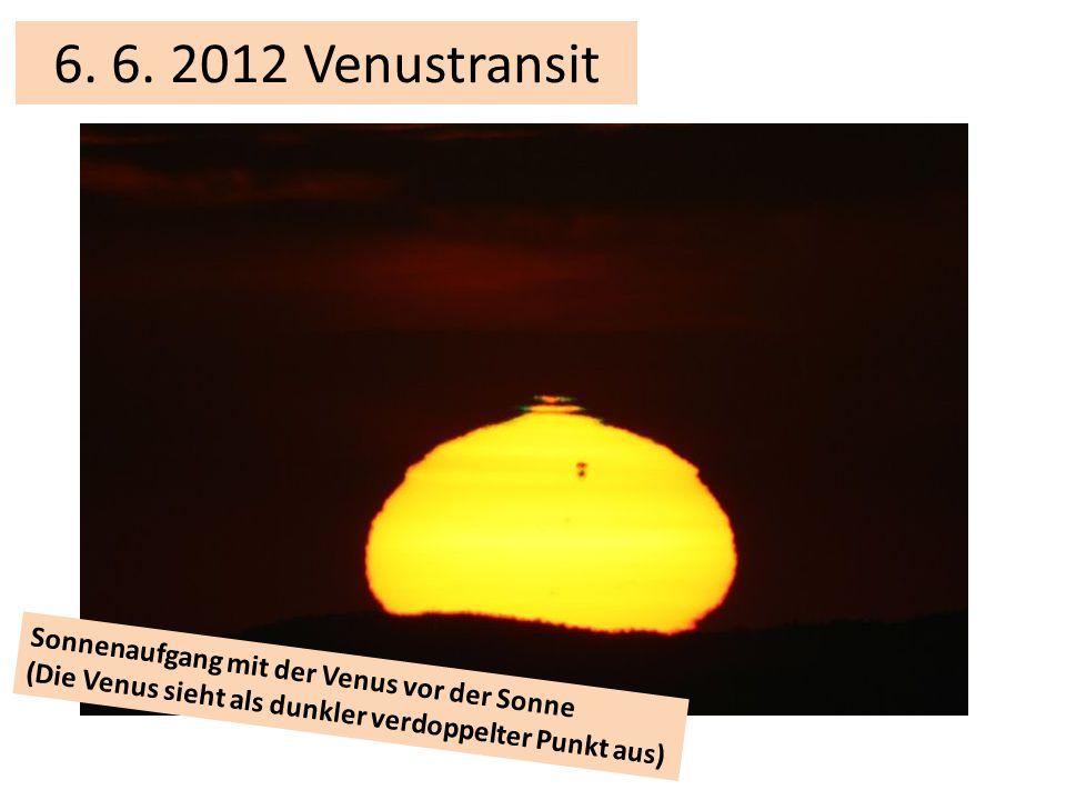 Sonnenaufgang mit der Venus vor der Sonne (Die Venus sieht als dunkler verdoppelter Punkt aus) 6.