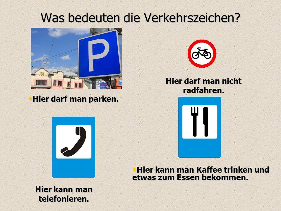 Was bedeuten die Verkehrszeichen? Hier darf man parken. Hier darf man parken. Hier darf man nicht radfahren. Hier kann man telefonieren. Hier kann man