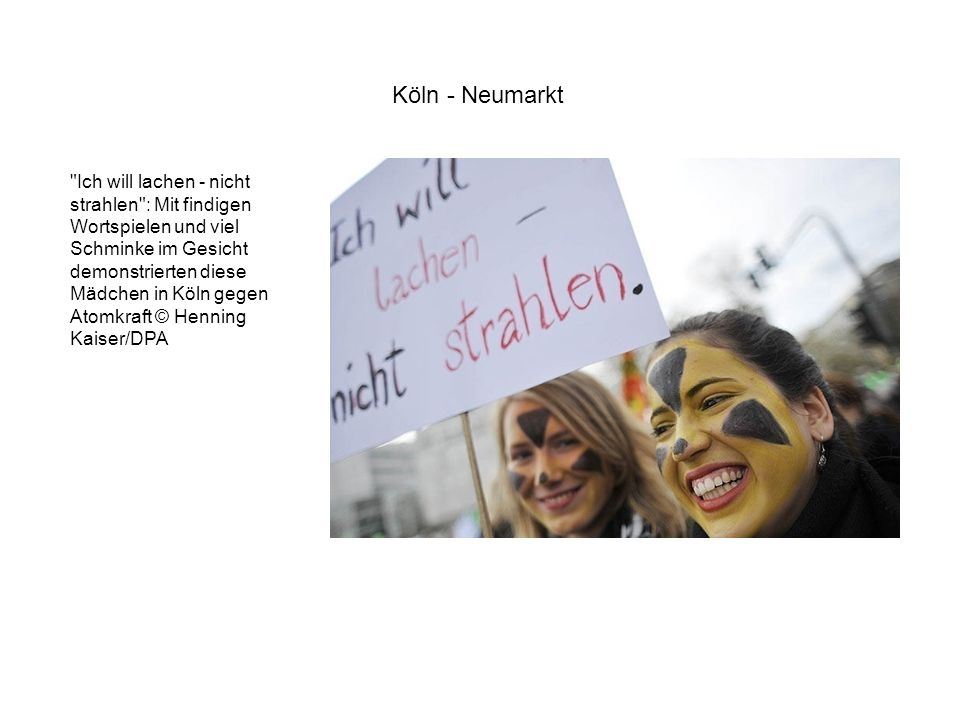 Ich will lachen - nicht strahlen : Mit findigen Wortspielen und viel Schminke im Gesicht demonstrierten diese Mädchen in Köln gegen Atomkraft © Henning Kaiser/DPA Köln - Neumarkt