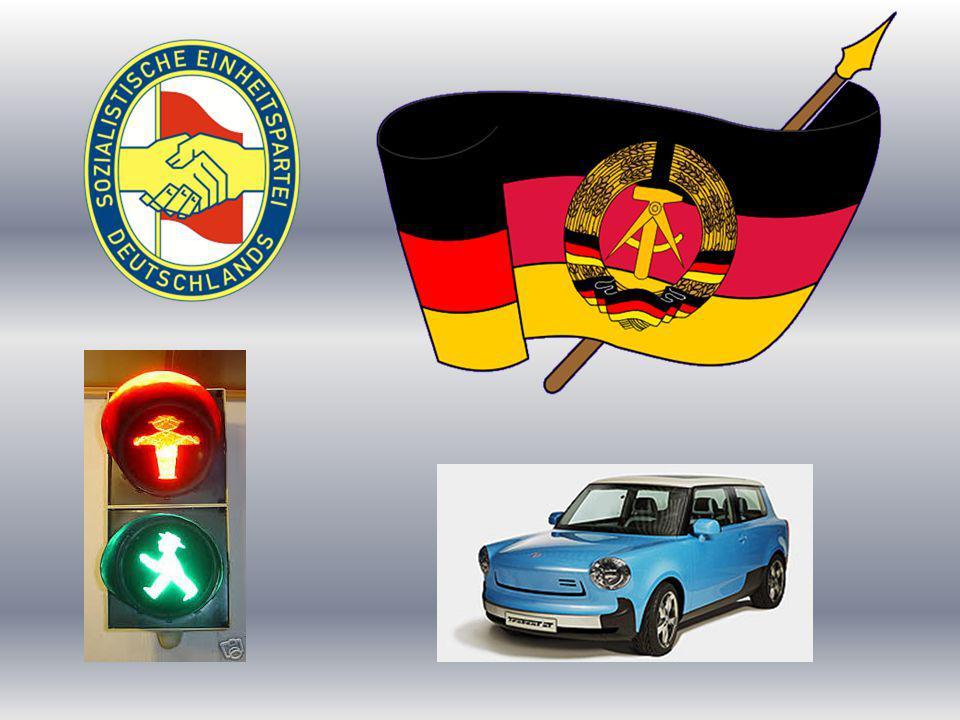 Die Flagge der DDR In der Mitte befindet sich das Wappen: Hammer, Zirkel und Ährenkranz - ein Symbol des Bündnisses von Arbeitern, Bauern und Intelligenz.