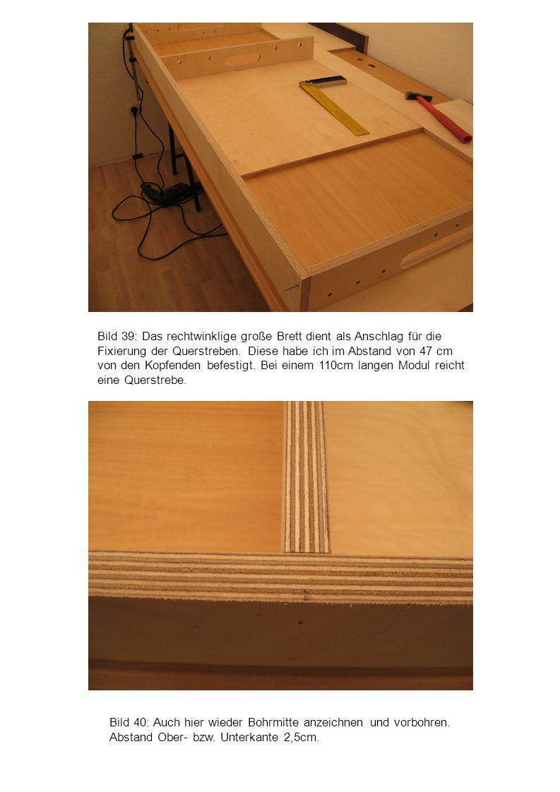 Bild 40: Auch hier wieder Bohrmitte anzeichnen und vorbohren. Abstand Ober- bzw. Unterkante 2,5cm. Bild 39: Das rechtwinklige große Brett dient als An