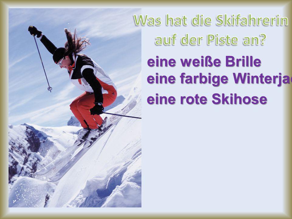 eine farbige Winterjacke eine rote Skihose eine weiße Brille