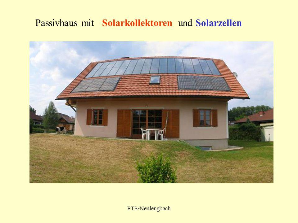 Passivhaus mit Solarkollektoren und Solarzellen