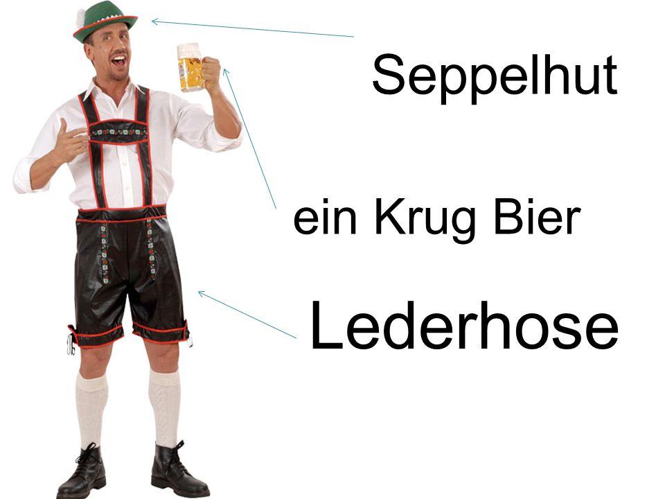 Lederhose Seppelhut ein Krug Bier
