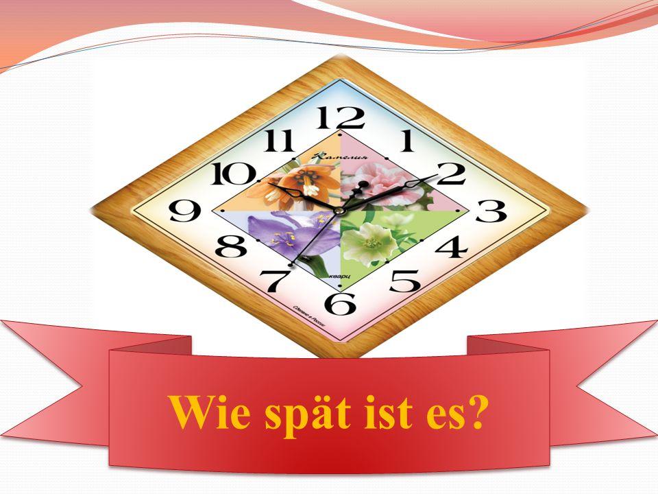 """[t] Die Uhr zeigt uns die Stunden an, der kleine Zeiger zeigt die Stunde, und jeder Schüler gut sehen kann und fragt er: """"Wann beginnt die erste Stunde? Zeigt, Stunden, gut, fragt, beginnt, erste, Stunde."""