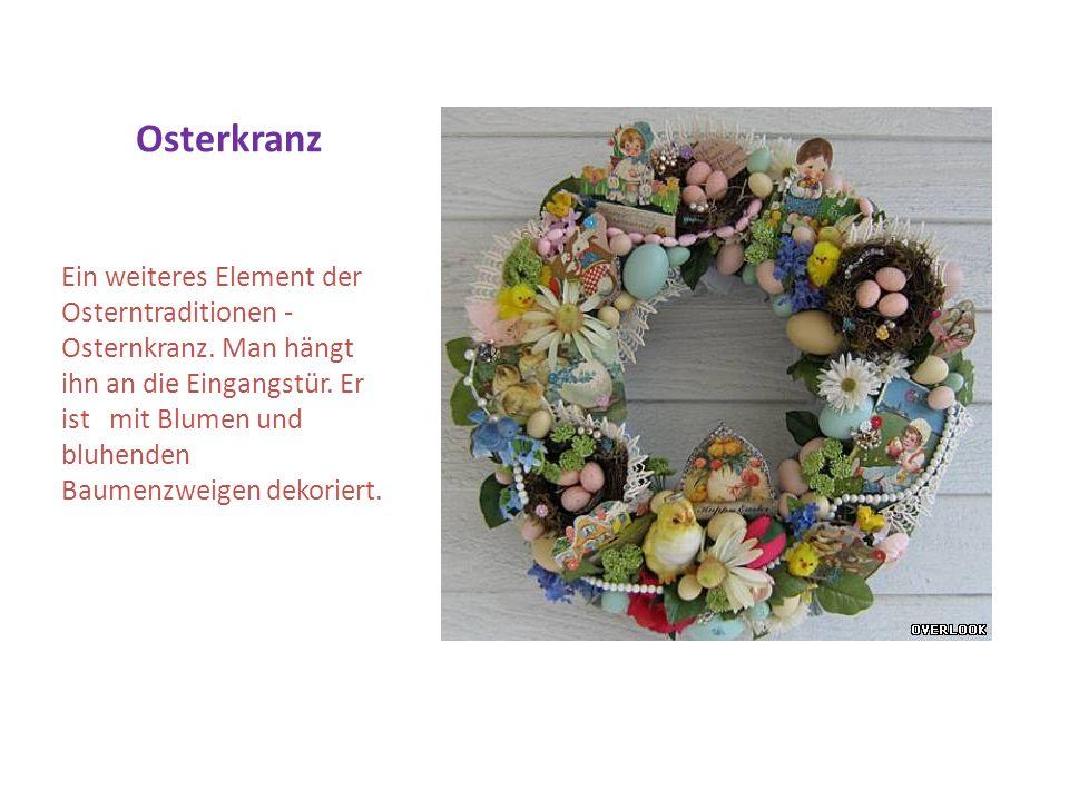 Osterkranz Ein weiteres Element der Osterntraditionen - Osternkranz. Man hängt ihn an die Eingangstür. Er ist mit Blumen und bluhenden Baumenzweigen d
