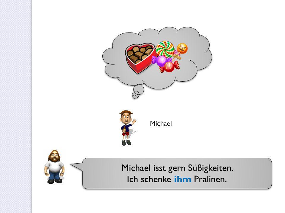 Michael isst gern Süßigkeiten. Ich schenke ihm Pralinen. Michael isst gern Süßigkeiten. Ich schenke ihm Pralinen. Michael