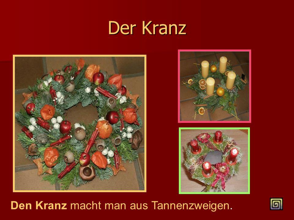 Die Weihnachtspyramiede  Sie hat 4 Etagen.  Auf jeder Etage stehen Figuren: Bergleuten, Tiere, Bäume, Jungen und Mädchen.  Auch Kerzen sind da. Sie