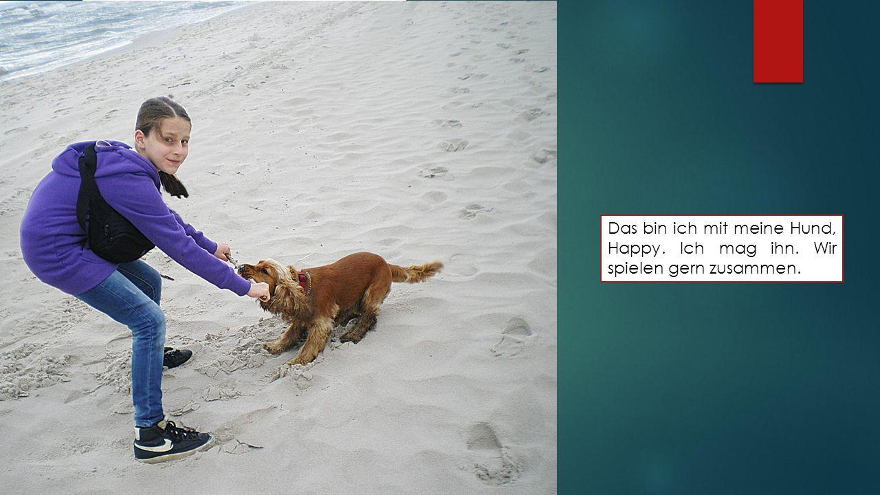 Das bin ich mit meine Hund, Happy. Ich mag ihn. Wir spielen gern zusammen.