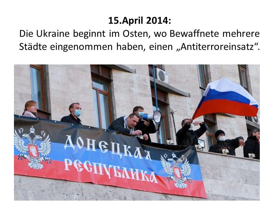 """15.April 2014: Die Ukraine beginnt im Osten, wo Bewaffnete mehrere Städte eingenommen haben, einen """"Antiterroreinsatz ."""