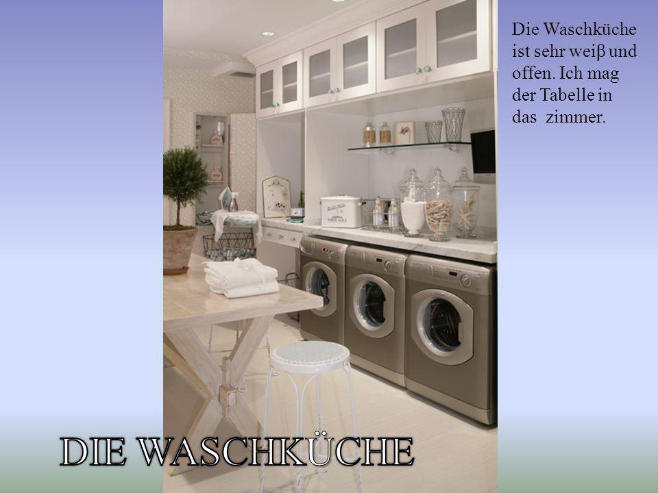 Die Waschküche ist sehr weiβ und offen. Ich mag der Tabelle in das zimmer.