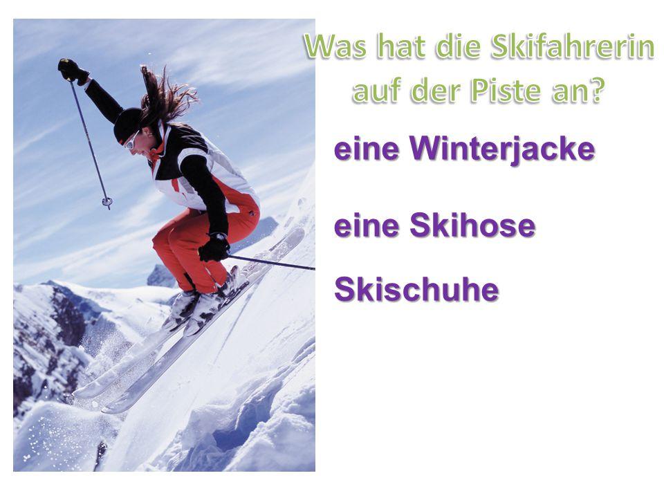 eine Winterjacke eine Skihose Skischuhe