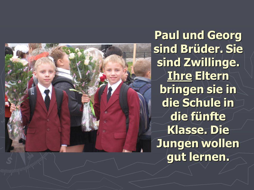 Paul und Georg sind Brüder. Sie sind Zwillinge. Ihre Eltern bringen sie in die Schule in die fünfte Klasse. Die Jungen wollen gut lernen.