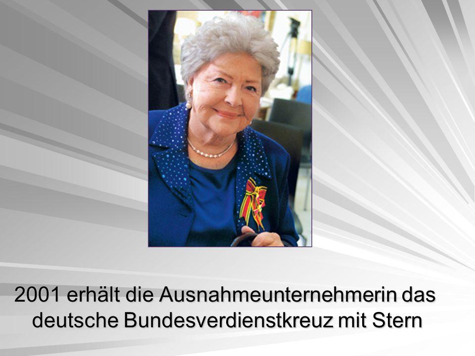 2001 erhält die Ausnahmeunternehmerin das deutsche Bundesverdienstkreuz mit Stern