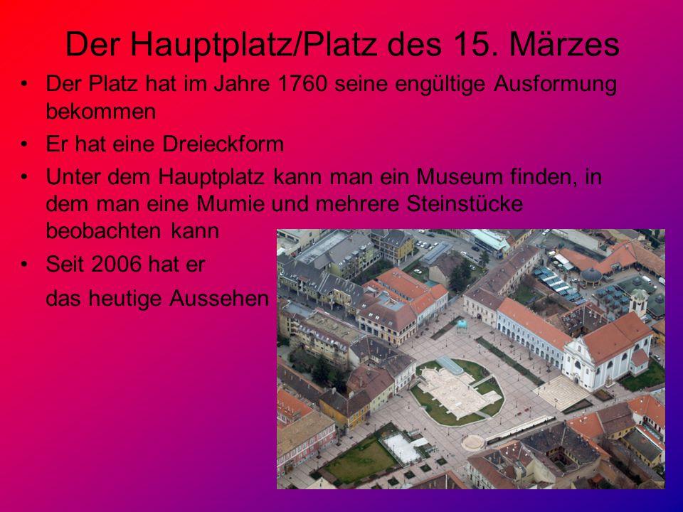 Der Hauptplatz/Platz des 15. Märzes Der Platz hat im Jahre 1760 seine engültige Ausformung bekommen Er hat eine Dreieckform Unter dem Hauptplatz kann