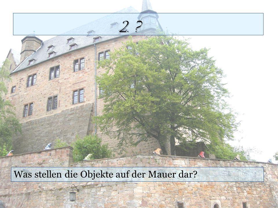 Was stellen die Objekte auf der Mauer dar? 2. ?