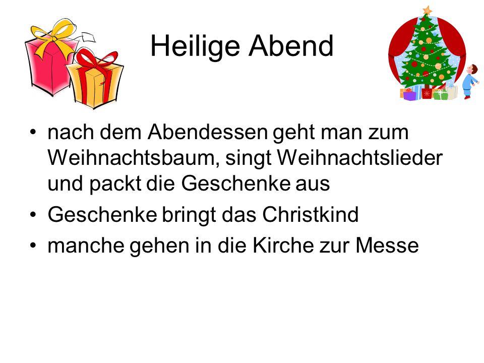 Heilige Abend nach dem Abendessen geht man zum Weihnachtsbaum, singt Weihnachtslieder und packt die Geschenke aus Geschenke bringt das Christkind manc