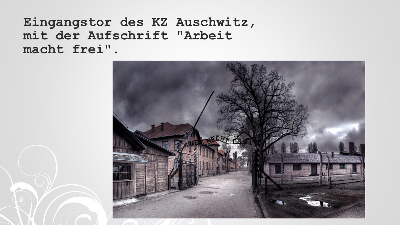 Eingangstor des KZ Auschwitz, mit der Aufschrift Arbeit macht frei .