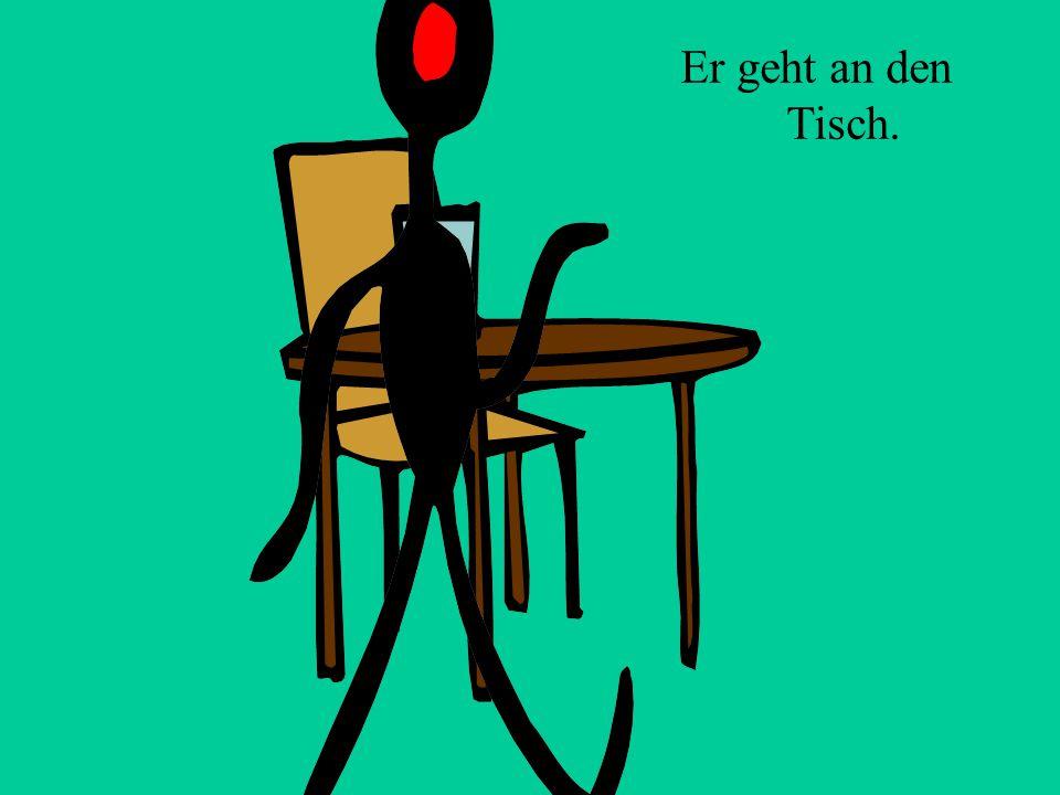 Er sitzt _________ dem Tisch.an