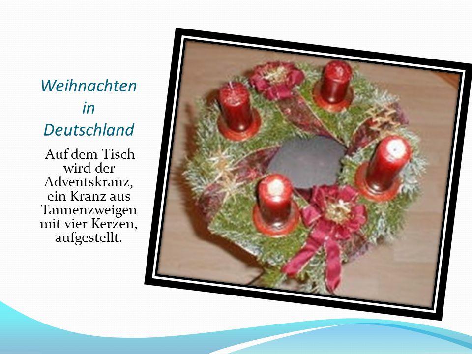 Weihnachten in Deutschland Auf dem Tisch wird der Adventskranz, ein Kranz aus Tannenzweigen mit vier Kerzen, aufgestellt.
