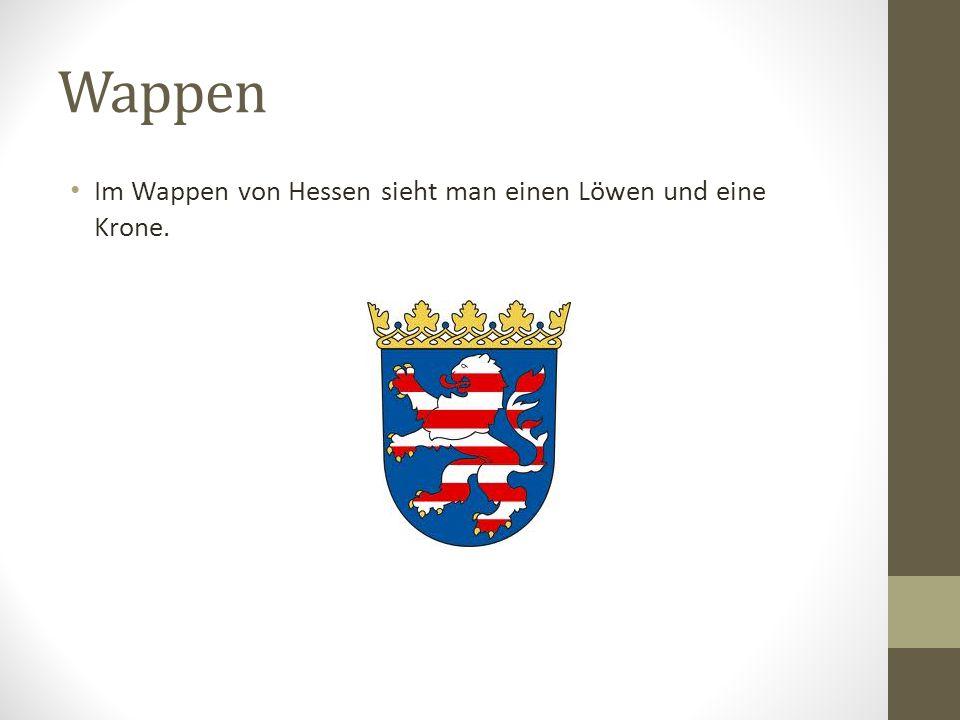Wappen Im Wappen von Hessen sieht man einen Löwen und eine Krone.