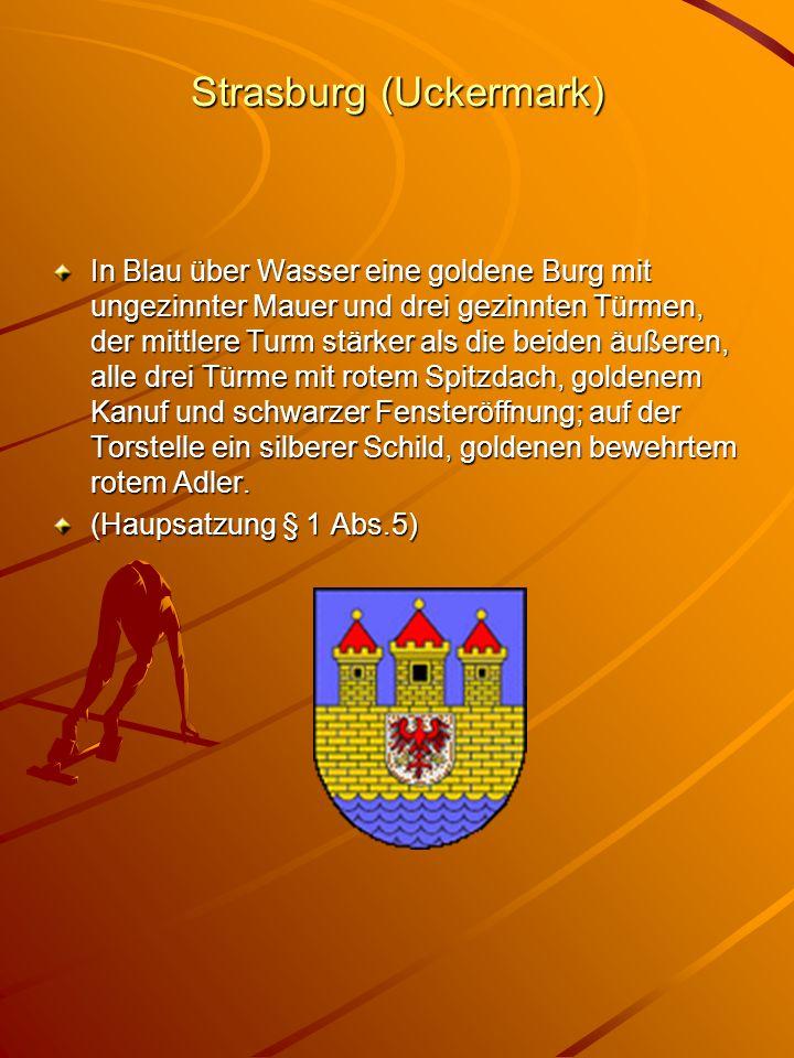 Strasburg (Uckermark) In Blau über Wasser eine goldene Burg mit ungezinnter Mauer und drei gezinnten Türmen, der mittlere Turm stärker als die beiden