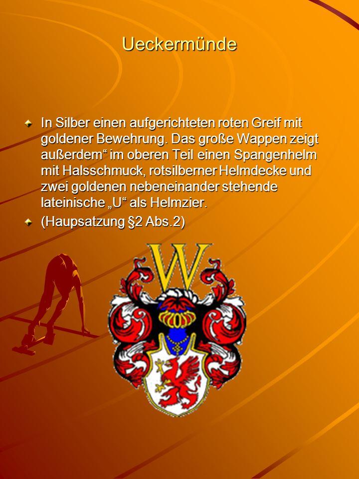 """Ueckermünde In Silber einen aufgerichteten roten Greif mit goldener Bewehrung. Das große Wappen zeigt außerdem"""" im oberen Teil einen Spangenhelm mit H"""