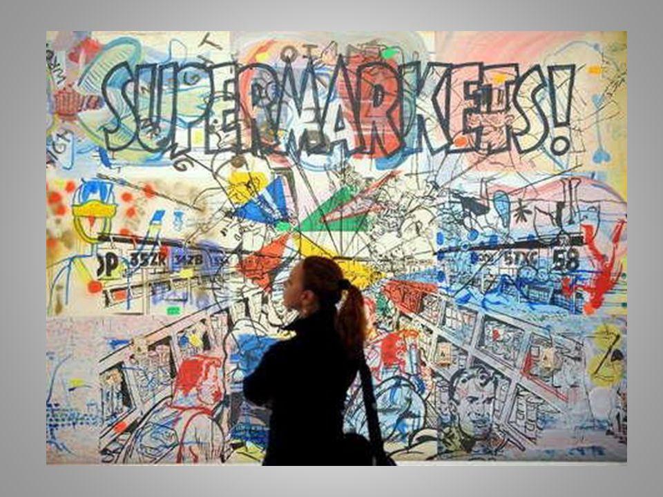 Der Maler und Grafiker Sigmar Polke betrachtet eines seiner Bilder kritisch.