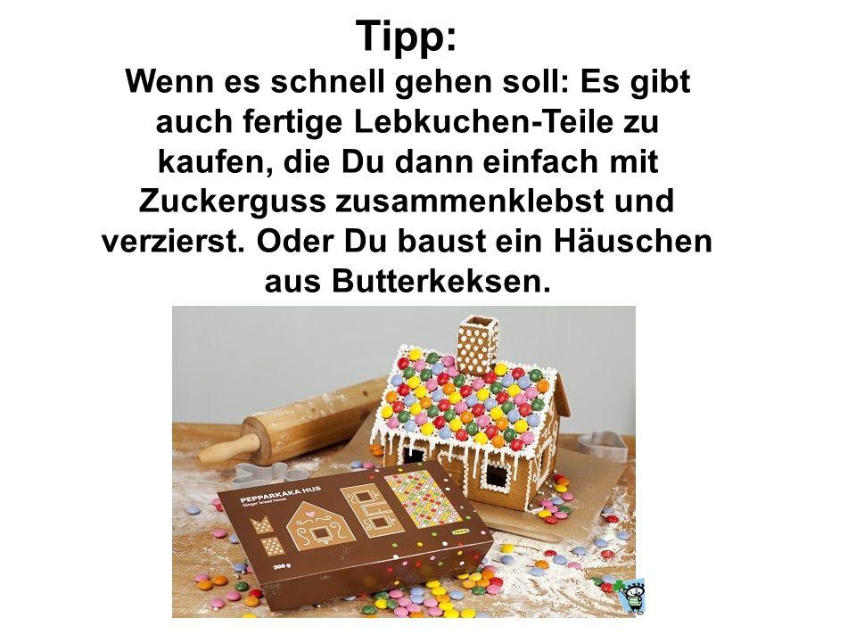 7. Sobald die Süßigkeiten festgetrocknet sind, zuerst die Vorderseite auf der unteren Kante mit dem Zuckerguss bemalen und auf der Bodenplatte festkle