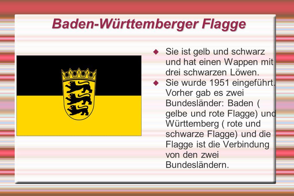 Baden-Württemberger Flagge SSie ist gelb und schwarz und hat einen Wappen mit drei schwarzen Löwen.