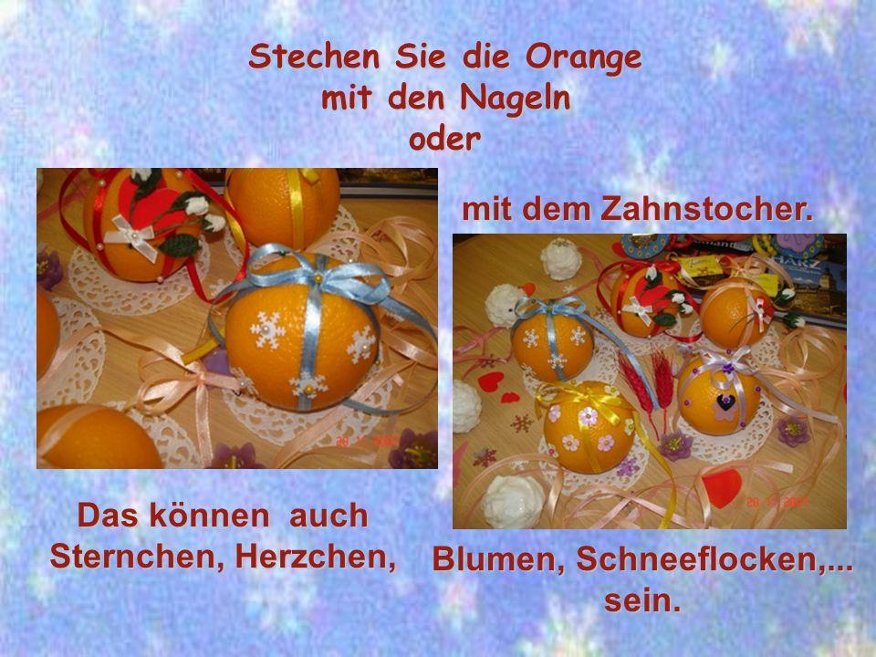 Stechen Sie die Orange mit den Nageln oder Das können auch Sternchen, Herzchen, Blumen, Schneeflocken,...