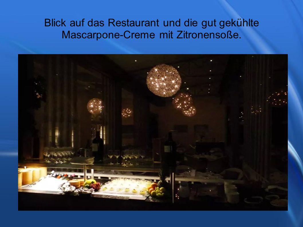 Blick auf das Restaurant und die gut gekühlte Mascarpone-Creme mit Zitronensoße.
