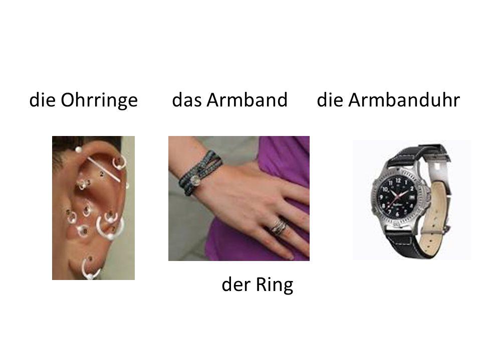 die Ohrringe das Armband die Armbanduhr der Ring